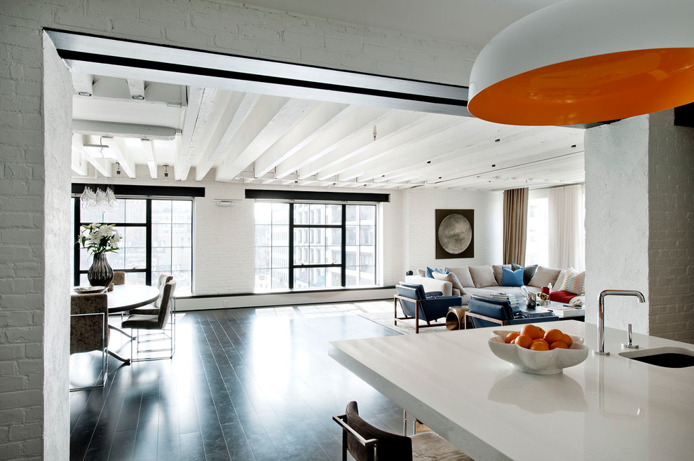Inspiration for an industrial open concept black floor living room remodel in New York with white walls