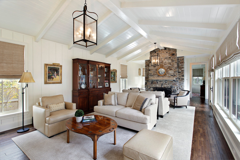 Large elegant living room photo in Chicago with white walls, a standard fireplace and a stone fireplace