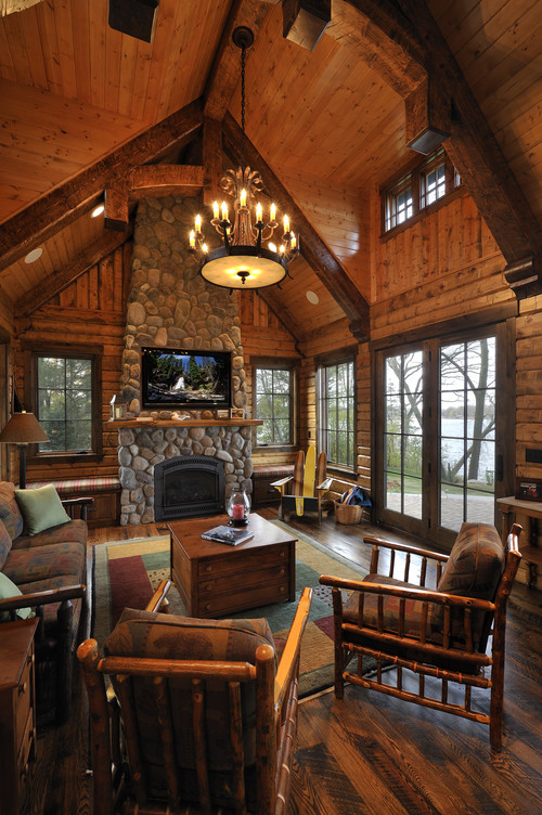 The rich hardwood flooring anchors this rustic living room  centered on a  stone fireplace beneath. 25 Sublime Rustic Living Room Design Ideas