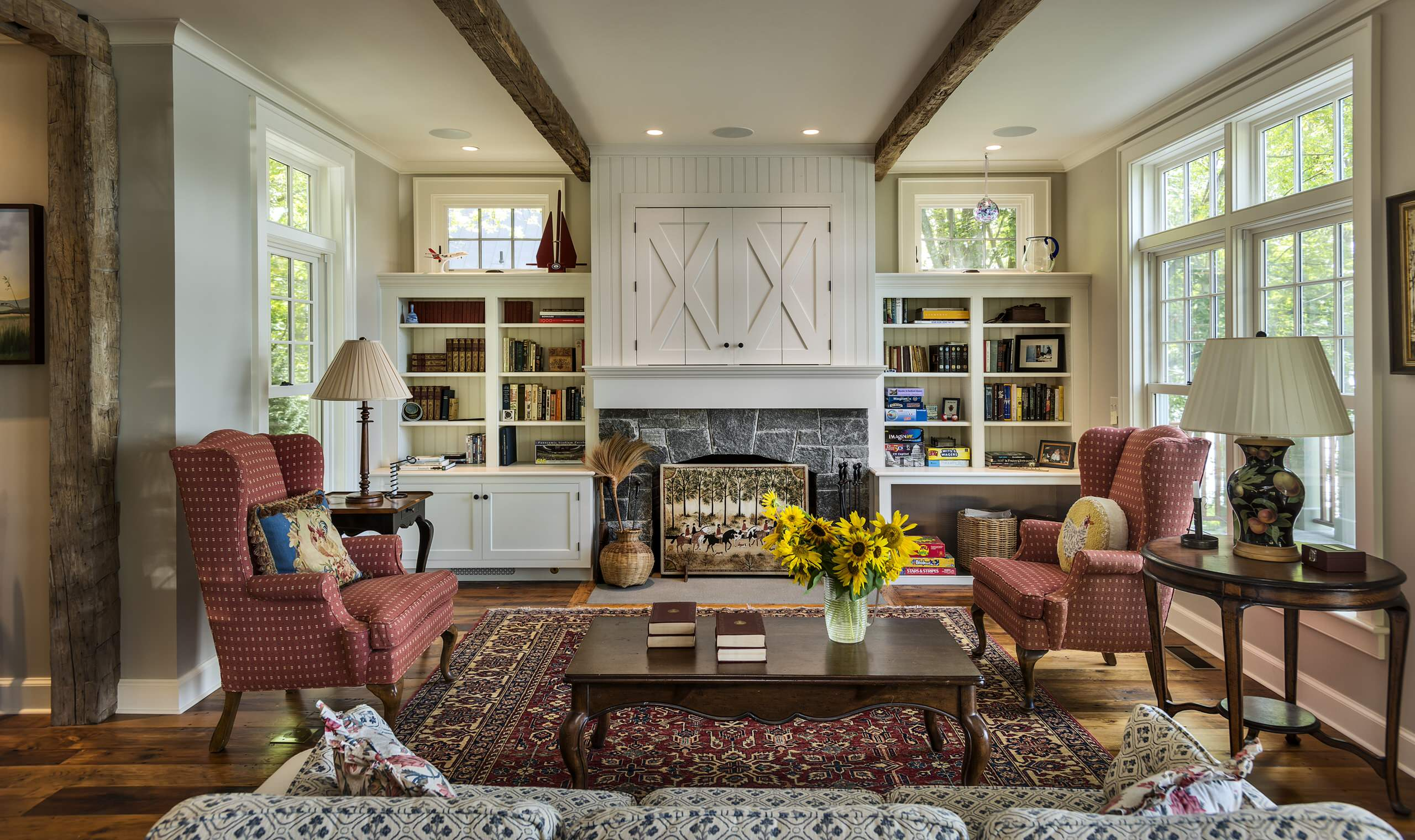 Living room - farmhouse living room idea in New York with a standard fireplace, a stone fireplace and gray walls