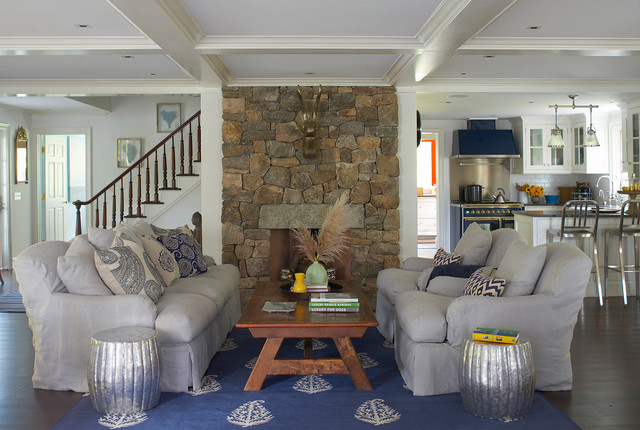 Inspiration for a mid-sized timeless open concept dark wood floor living room remodel in New York with white walls, a standard fireplace, a stone fireplace and no tv