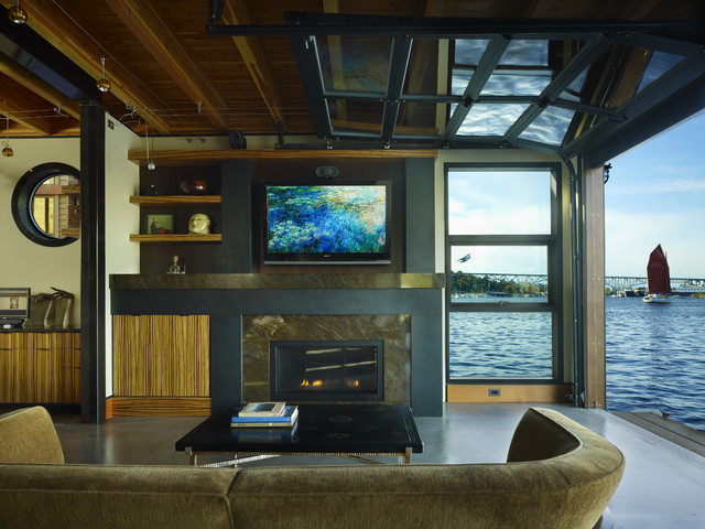 Living room with views to Lake Union, glass overhead door opened to the water. modern living room