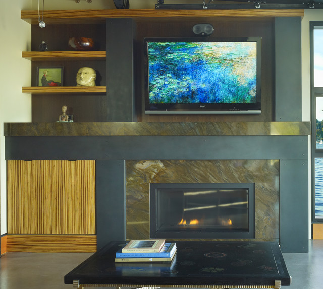 Fireplace with mill finish steel and zebra wood. modern living room
