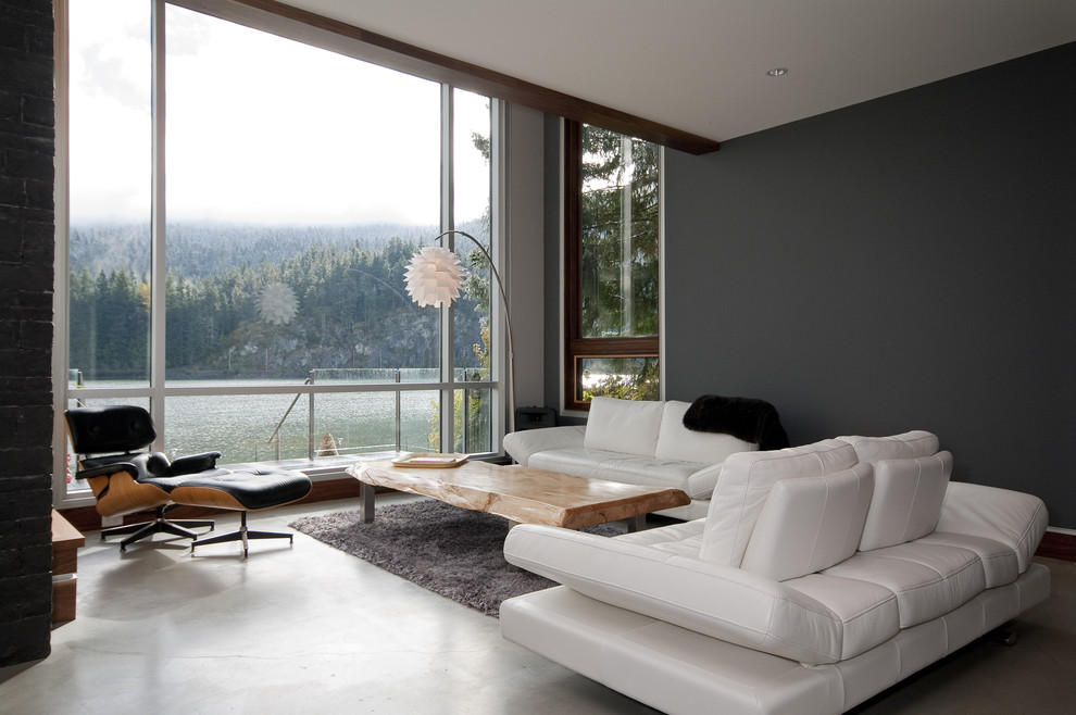 Large trendy concrete floor living room photo in Vancouver with black walls