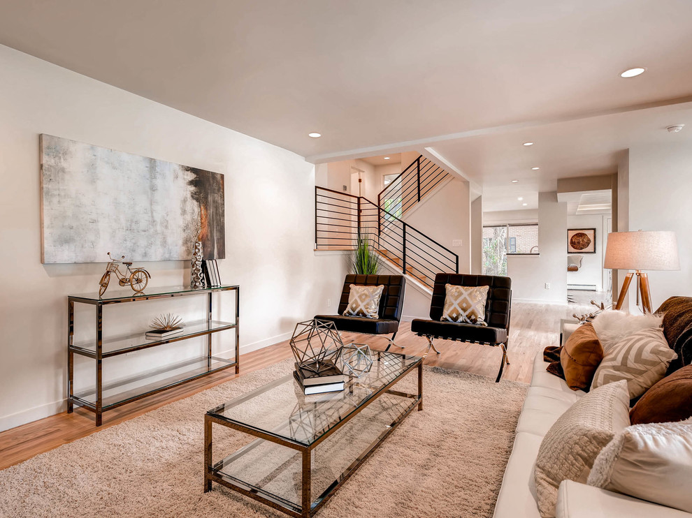 Living room - contemporary open concept medium tone wood floor living room idea in Denver with beige walls, no fireplace and no tv