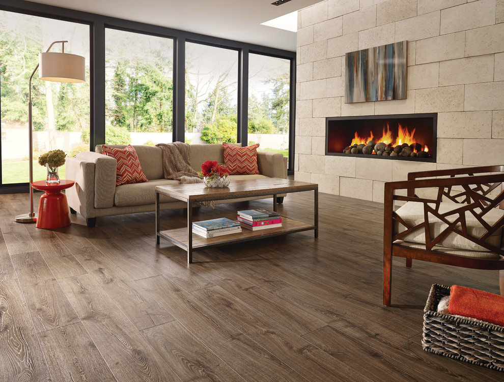 Inspiration for a large transitional open concept medium tone wood floor living room remodel in Toronto with beige walls and a ribbon fireplace