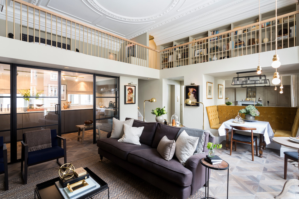 Example of a large transitional open concept and formal medium tone wood floor living room design in London with white walls