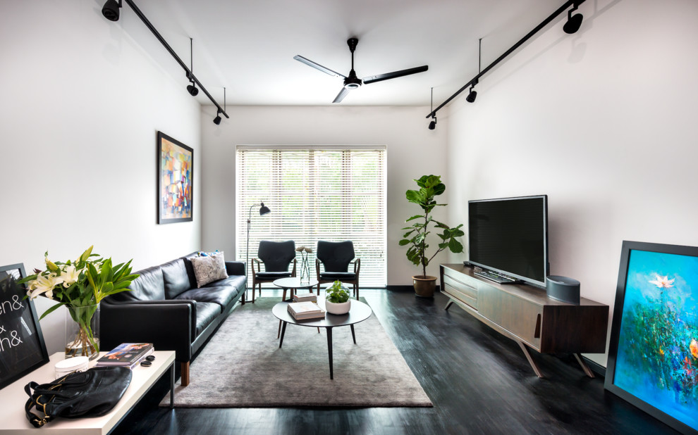 Inspiration for a scandinavian dark wood floor living room remodel in Singapore with white walls, no fireplace and a tv stand