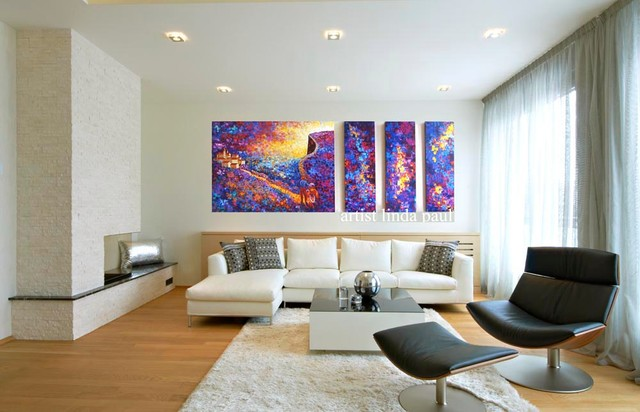 large colorful wall art paintings in black and white living room