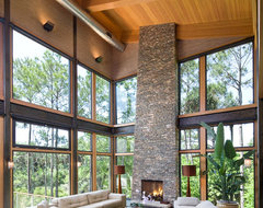 Large glass area focuses view to lagoon. contemporary-living-room