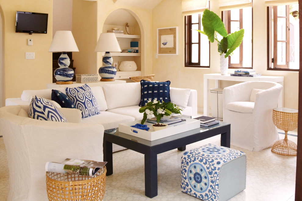 Example of a tuscan living room design in Other