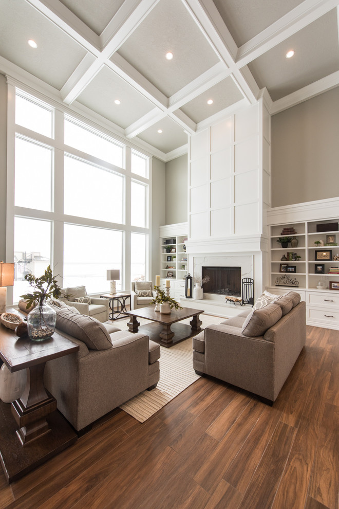 Example of a transitional open concept medium tone wood floor and brown floor living room design in Salt Lake City with beige walls, a standard fireplace and a wood fireplace surround