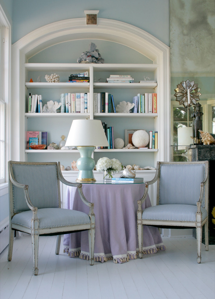 Inspiration for a large coastal living room remodel in New York with blue walls and no fireplace