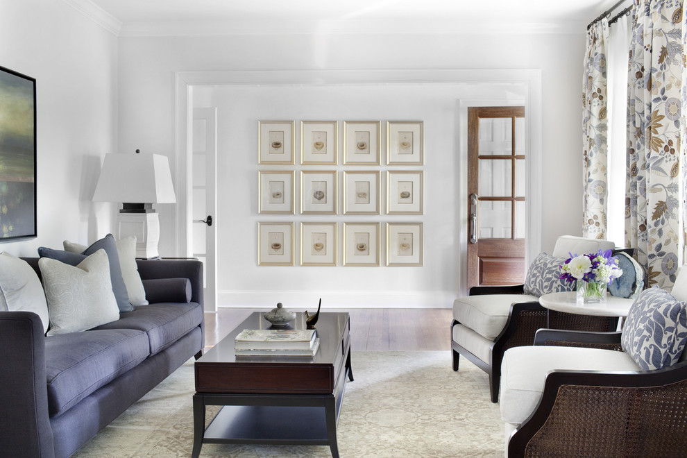 Example of a classic living room design in Atlanta with white walls