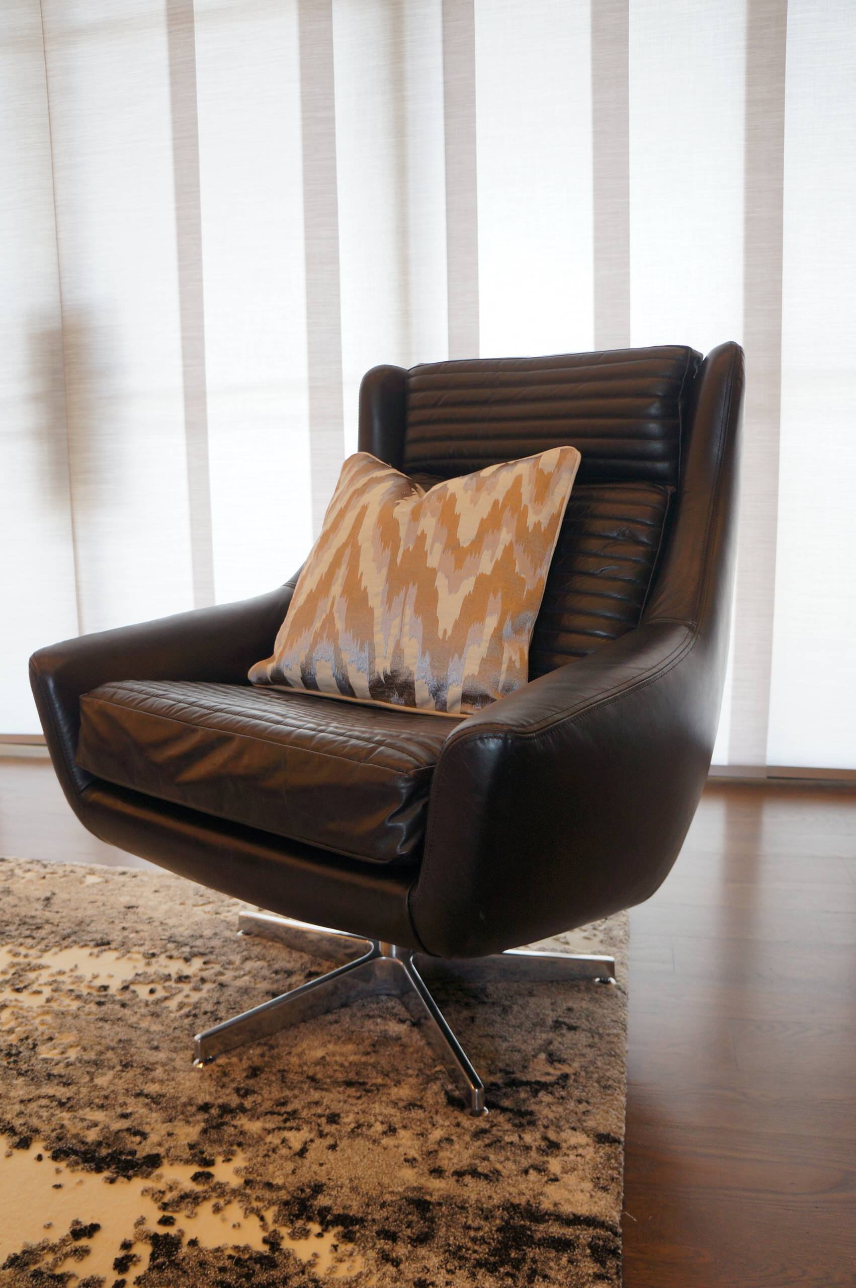 Leather swivel chair in main living area