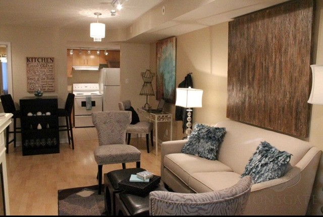 Liberty village 500 sq foot condo vacant staging for Living room square feet