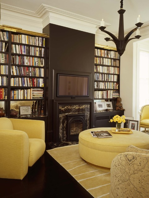 Example of an eclectic living room library design in Other
