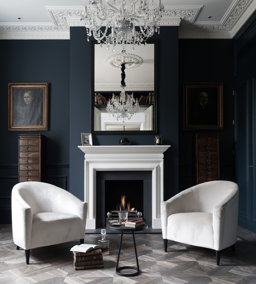 Living room - mid-sized transitional formal and enclosed gray floor living room idea in London with blue walls and a standard fireplace