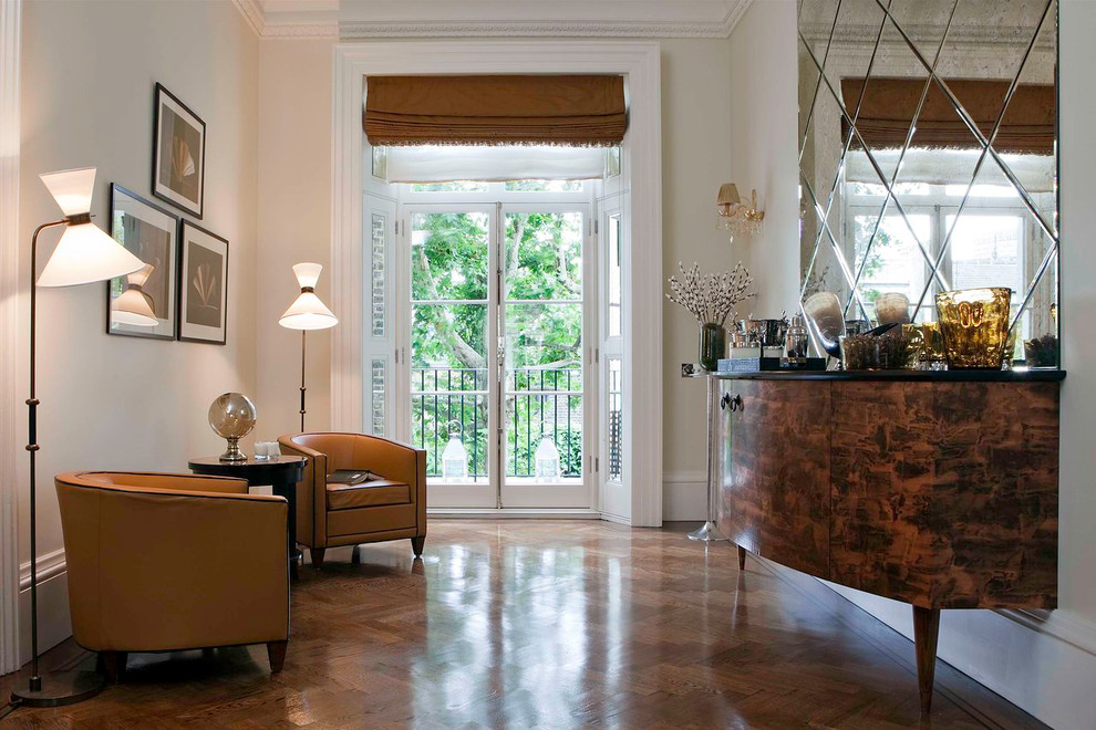 Example of a mid-sized transitional dark wood floor and brown floor living room design in London with white walls