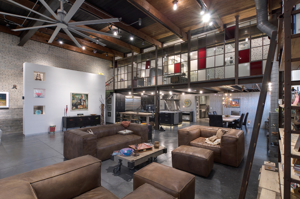 Inspiration for an industrial concrete floor living room remodel in Grand Rapids