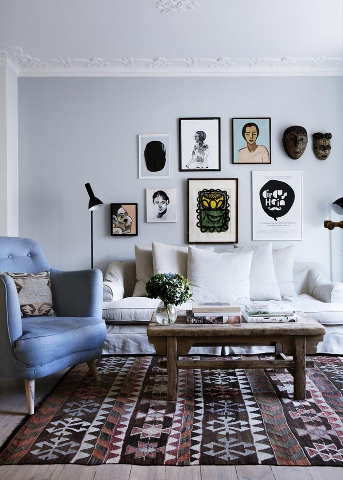 Inspiration for a bohemian living room in Los Angeles with blue walls and beige floors.