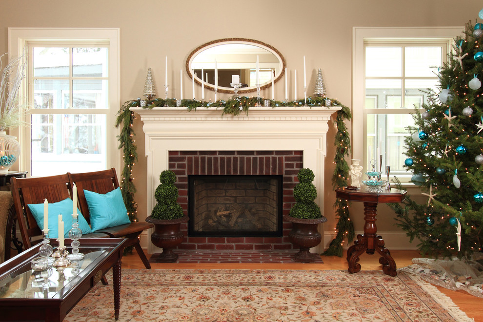 Inspiration for a country medium tone wood floor living room remodel in Minneapolis with beige walls, a standard fireplace and a brick fireplace