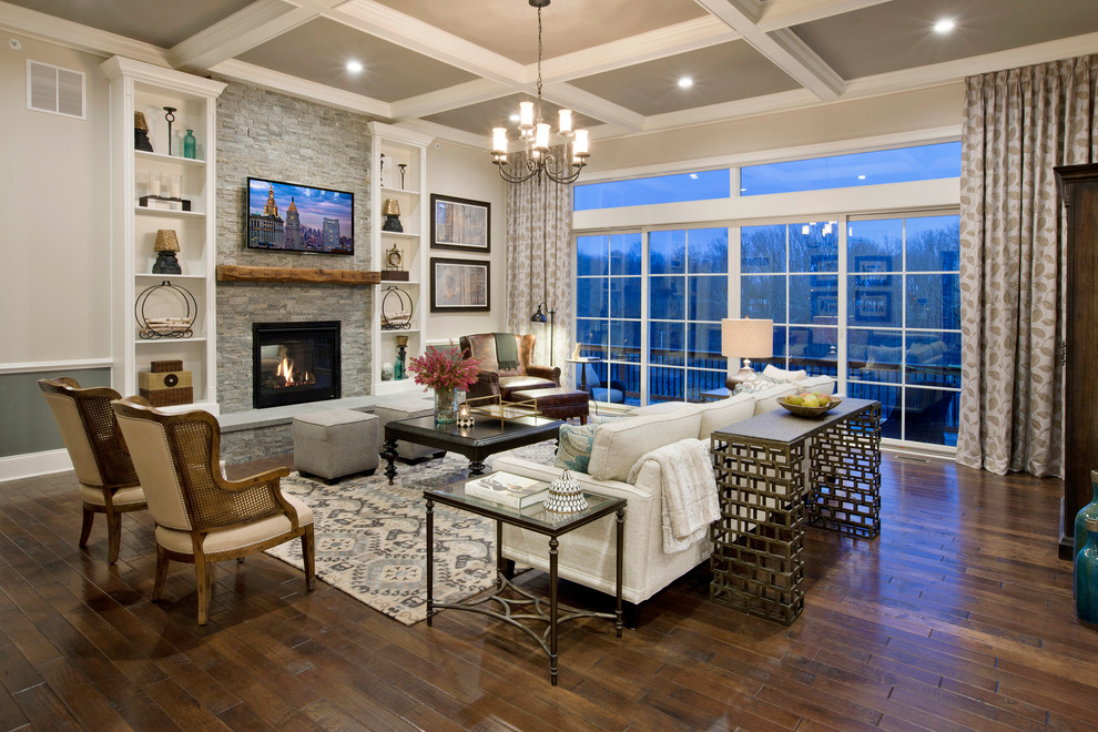 Elegant dark wood floor living room photo in Philadelphia with gray walls, a standard fireplace, a stone fireplace and a wall-mounted tv
