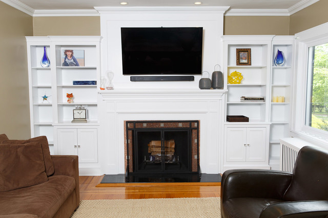 Example of a mid-sized transitional enclosed medium tone wood floor living room library design in New York with beige walls, a standard fireplace, a tile fireplace and a wall-mounted tv