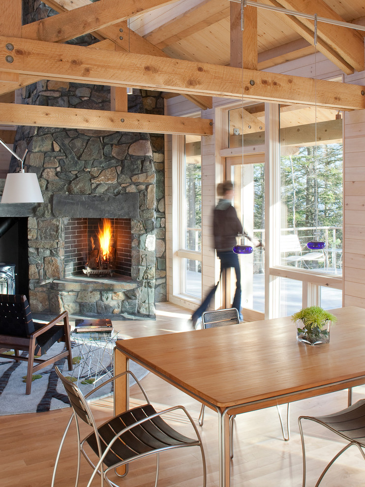 Inspiration for a rustic living room remodel in Portland Maine with a stone fireplace