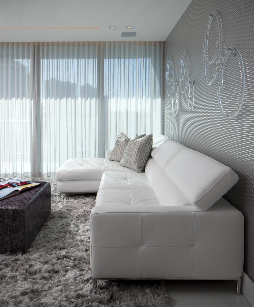 Example of a mid-sized minimalist formal living room design in Miami with gray walls