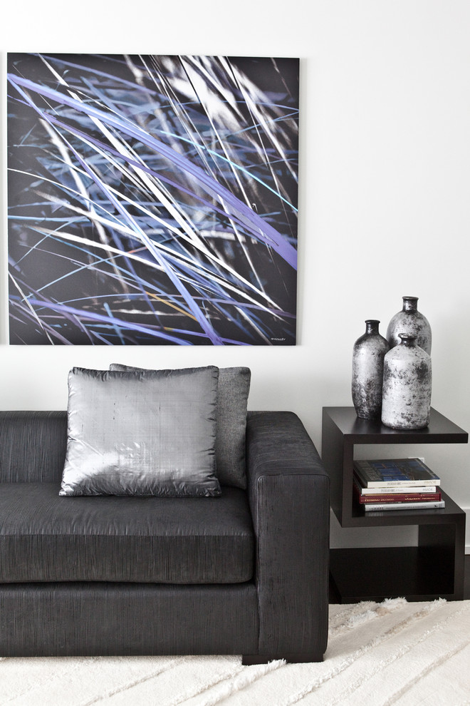 Inspiration for a large modern open concept dark wood floor living room remodel in Toronto with gray walls