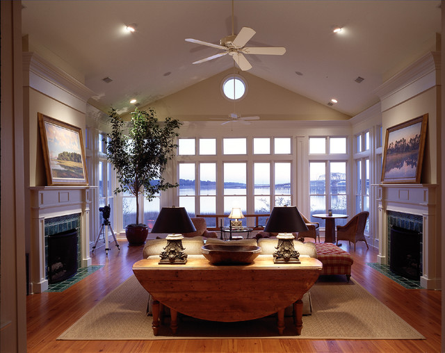 Coastal living room photo in Atlanta with a standard fireplace and a tile fireplace