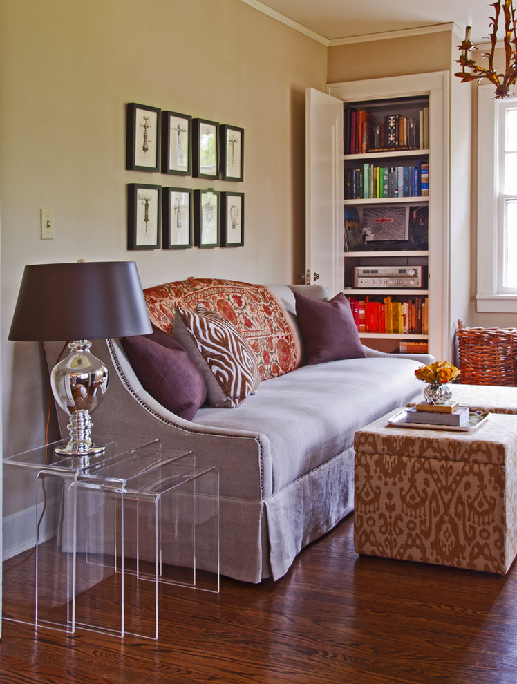 Inspiration for an eclectic living room remodel in Kansas City with beige walls