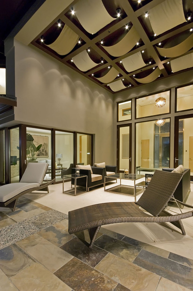 Living room - contemporary slate floor living room idea in San Francisco with gray walls