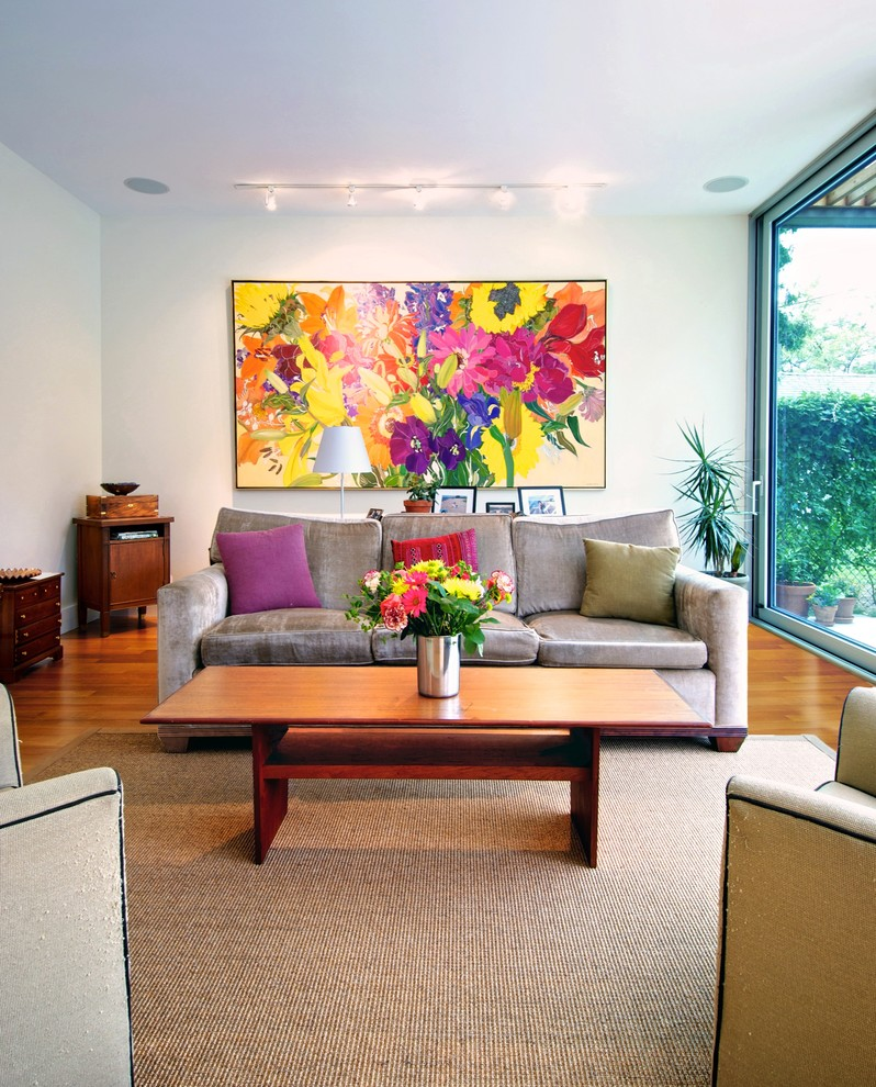 Inspiration for a modern living room remodel in Toronto with white walls