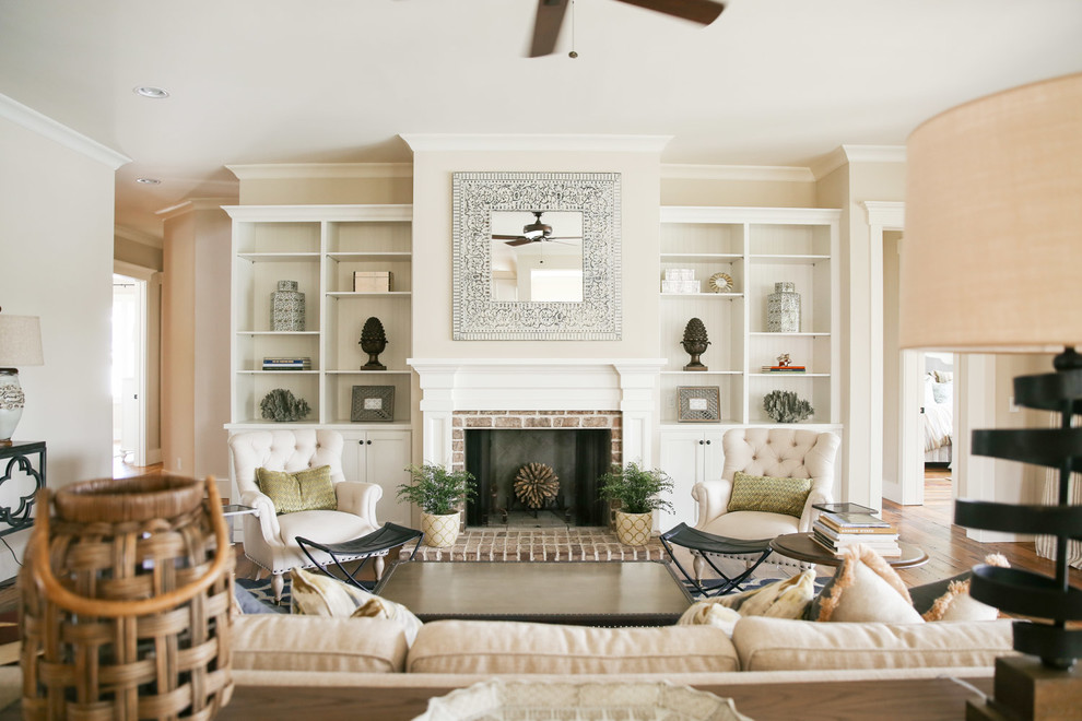 Living room - large coastal enclosed medium tone wood floor living room idea in Atlanta with a standard fireplace, a brick fireplace and no tv