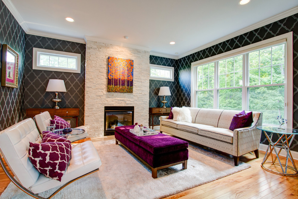 Inspiration for a mid-sized contemporary formal and enclosed light wood floor living room remodel in New York with black walls, a standard fireplace and a stone fireplace
