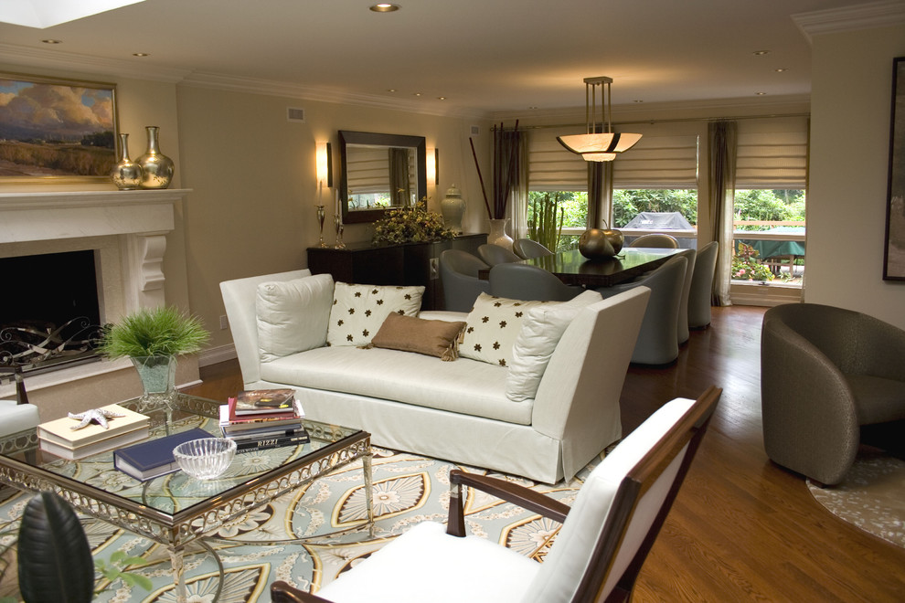Inspiration for a large contemporary formal and open concept medium tone wood floor living room remodel in New York with beige walls, a standard fireplace and no tv