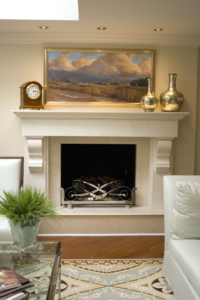 Example of a large trendy open concept medium tone wood floor living room design in New York with beige walls, a standard fireplace, a music area and no tv