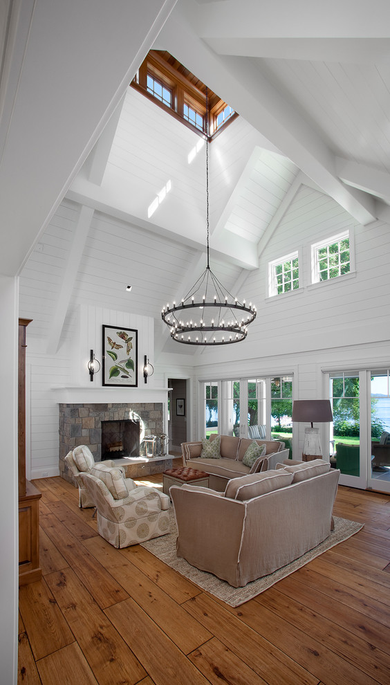 Living room - large traditional living room idea in Grand Rapids with white walls