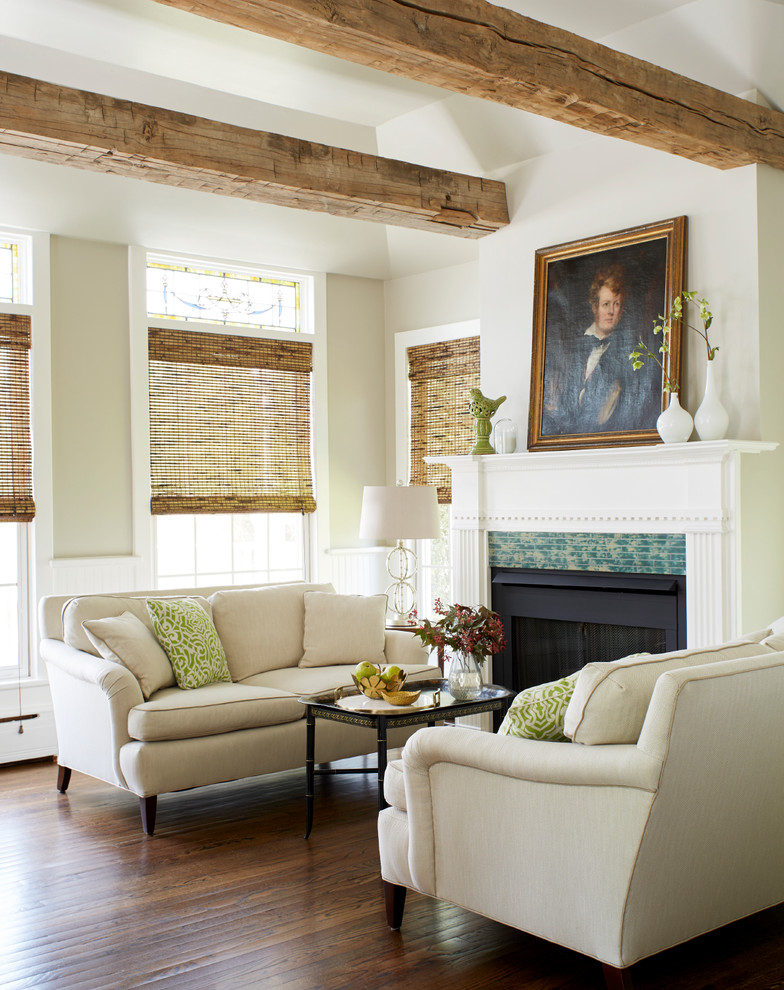 Inspiration for a mid-sized timeless open concept dark wood floor and brown floor living room remodel in New York with beige walls, a standard fireplace, a tile fireplace and no tv