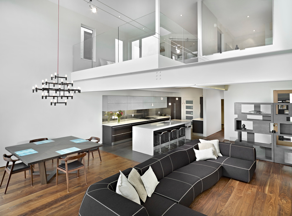 Inspiration for a modern open concept living room remodel in Edmonton with white walls