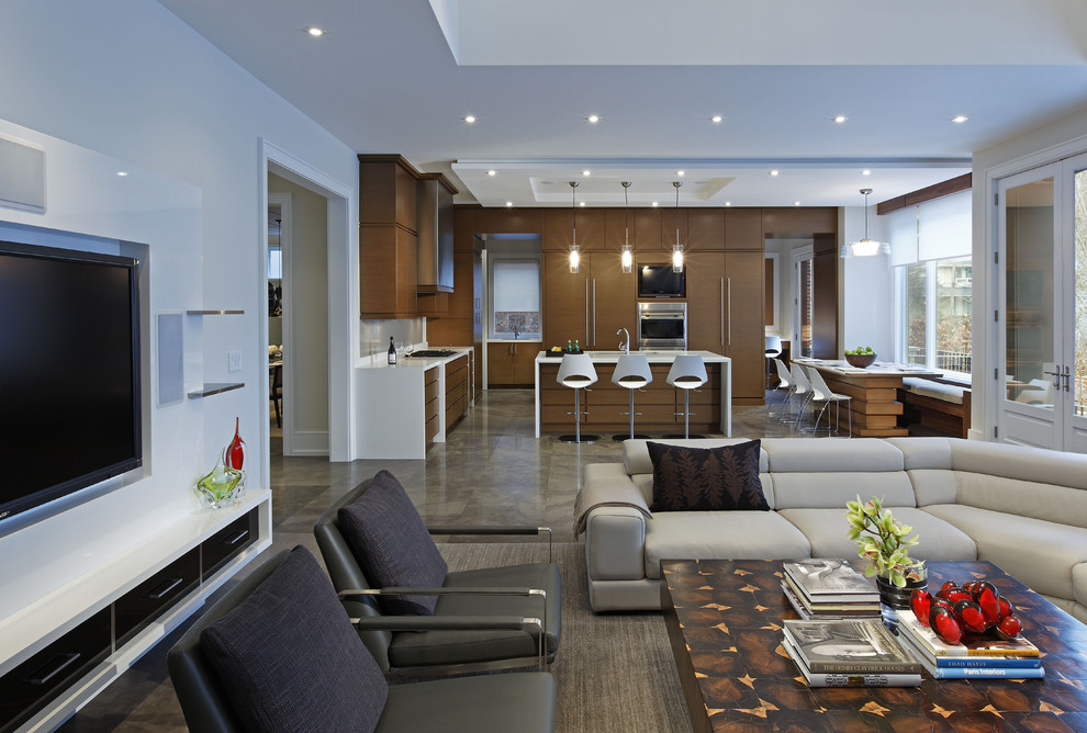 Example of a large trendy open concept concrete floor living room design in Toronto with white walls, a standard fireplace, a concrete fireplace and a media wall