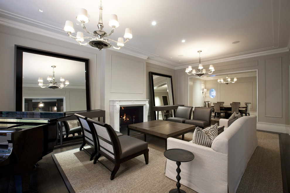 Example of a trendy formal living room design in Chicago with gray walls and a standard fireplace