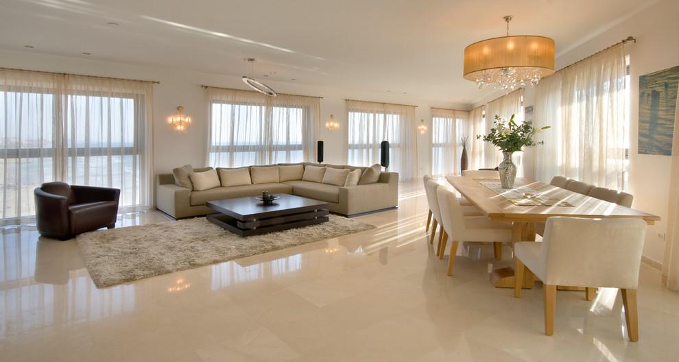 Example of a trendy open concept beige floor living room design in Other