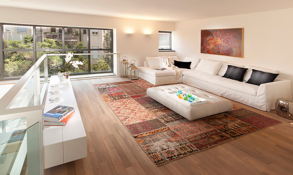 Example of an eclectic loft-style living room design in Other with white walls, no fireplace and no tv