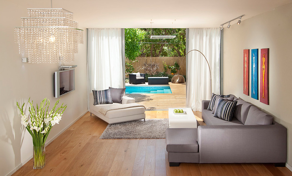 Living room - mid-sized contemporary living room idea in Other with a wall-mounted tv
