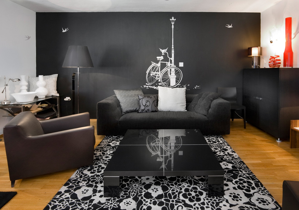 Living room - contemporary living room idea in Other with black walls