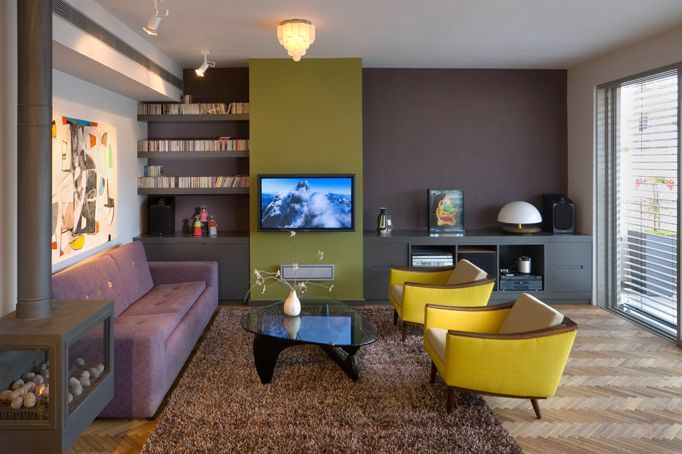 Example of a trendy living room design in Other with gray walls and a wall-mounted tv