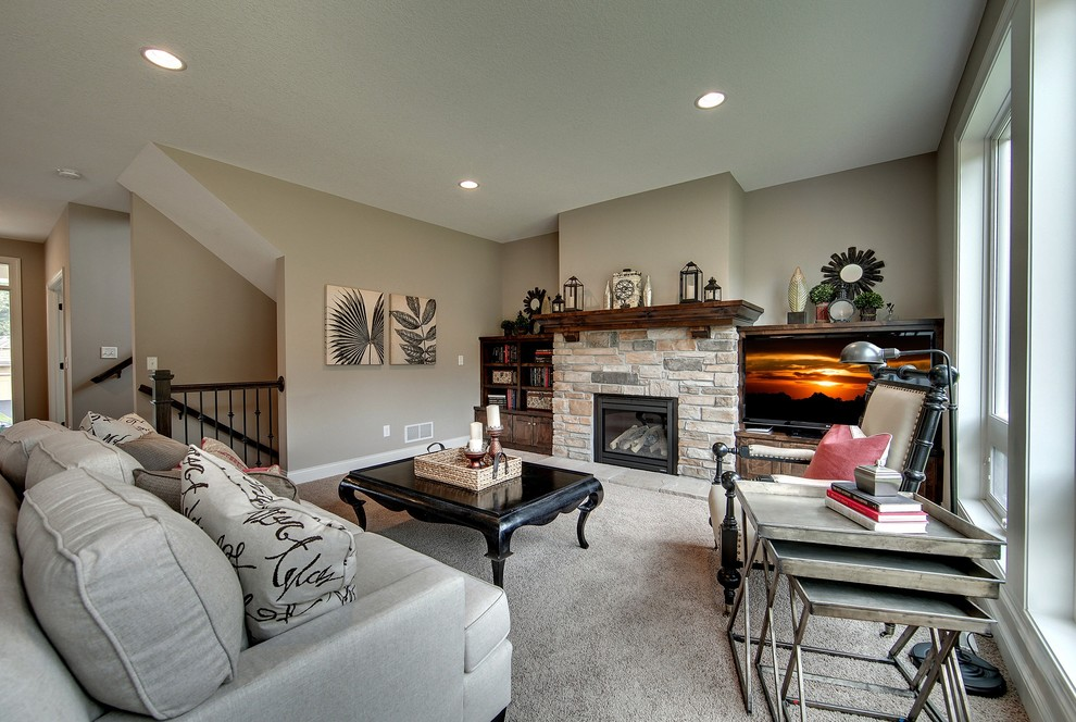 Large elegant open concept carpeted living room photo in Minneapolis with gray walls, a standard fireplace, a stone fireplace and a media wall
